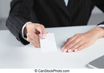 Close-up of business card in women hand