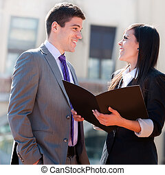 Close up of business couple outdoors..