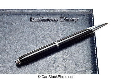 close-up of business diary with pen isolated over white