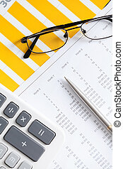 Close up of business documents and glasses