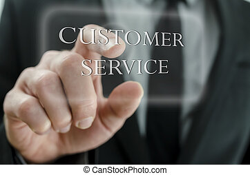 Close up of business man pointing at Customer service icon on a virtual screen.