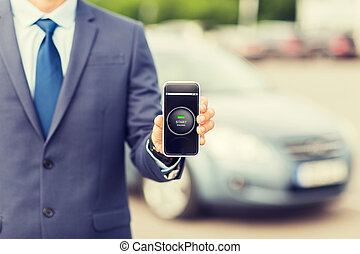 close up of business man with smartphone app - transport,...