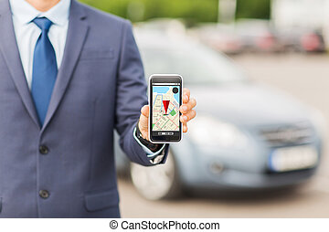 close up of business man with smartphone navigator -...