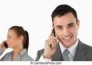 Close up of business partners on the phone