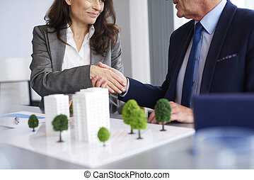 Close up of business partners shaking hands