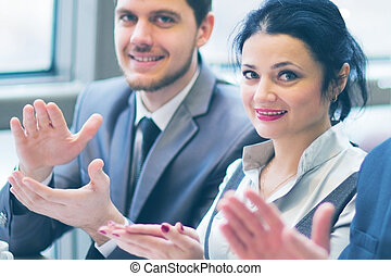 Close-up of business people clapping hands