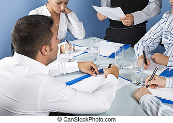 Close up of business people writing at having a meeting