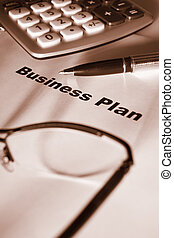 Close up of business plan differential focus sepia tone