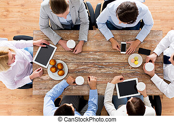 close up of business team drinking coffee on lunch - ...