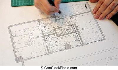 Close up of business woman working on blueprints