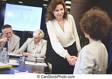 Close up of business women shaking hands