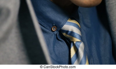 Close up of businessman arranging his jacket, side view