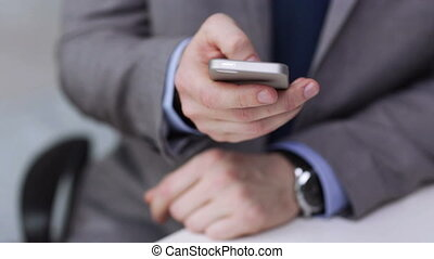 close up of businessman calling on smartphone