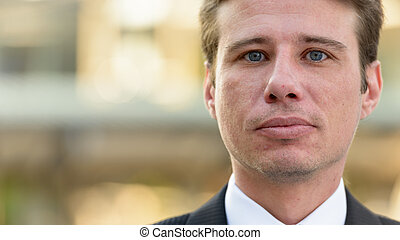 Close up of businessman face outdoors in city
