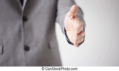 close up of businessman giving hand for handshake