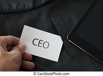 close up of businessman hand picking business card reading CEO f