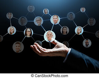 close up of businessman hand with contacts icons - business,...