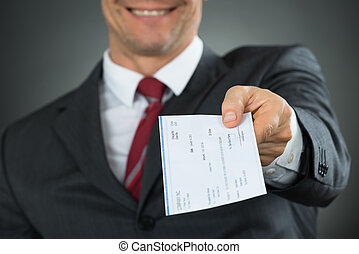 Close-up Of Businessman Hands Giving Cheque