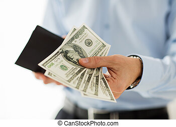 close up of businessman hands holding money - people, ...