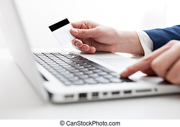 Close Up of businessman hands using laptop computer with blank copy space screen