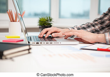 Close Up of businessman hands using laptop computer