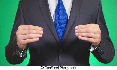 Close-up of businessman hands wearing formal suit. something...