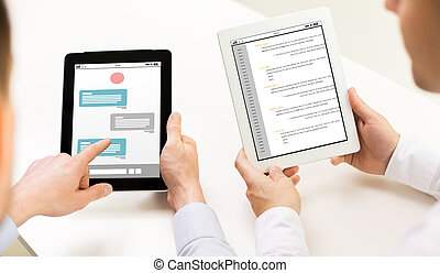 close up of businessman hands with tablet pc