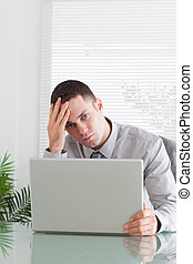 Close up of businessman having a problem with his laptop