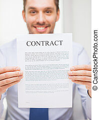 close up of businessman holding contract document