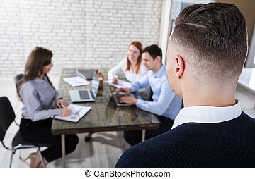 Businessman Looking At His Colleague