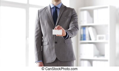 close up of businessman showing white blank card - business,...