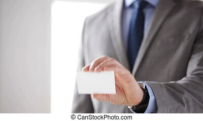 close up of businessman showing white blank card