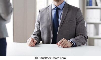 close up of businessman taking money bribe