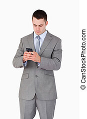 Close up of businessman texting