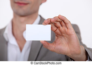 Close-up of businessman with card