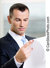 Close up of businessman with draft