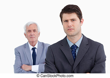 Close up of businessman with his boss behind him