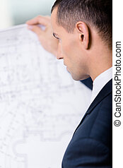 Close up of businessman with layout