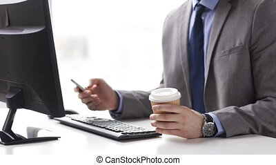 close up of businessman with smartphone and coffee