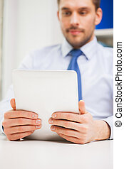close up of businessman with tablet pc in office