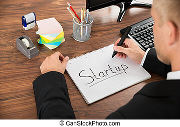 Businessman With The Text Start-up On Notebook