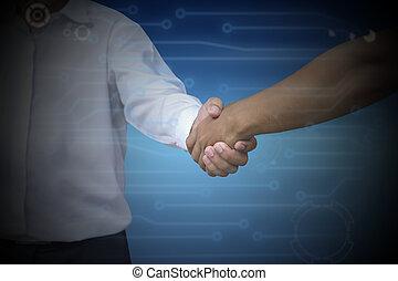 Close up of businessmen shaking hands dark blue color Light...