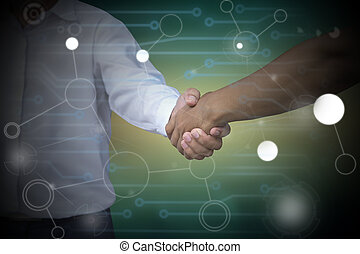 Close up of businessmen shaking hands on abstract technology...