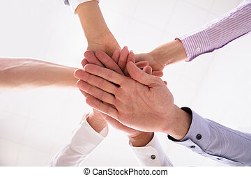 Close-up Of Businesspeople Stacking Hands