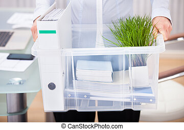 Close-up Of Businessperson Carrying Office Supply In Plastic Container