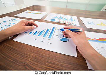 Businessperson Hands With Graphs