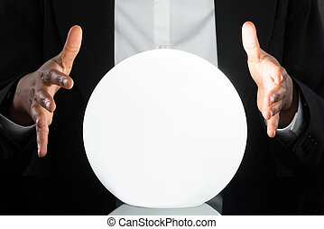 Businessperson Predicting Future With Crystal Ball -...