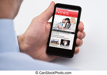 Close-up Of Businessperson Reading Online News On Mobile Phone