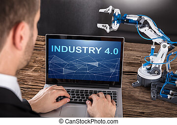 Working On Design Of Industrial Robot Arm On Laptop - Close-...