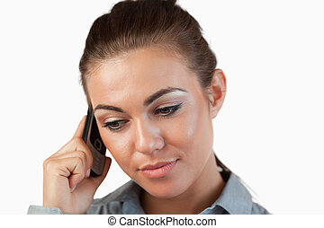 Close up of businesswoman listening closely to caller ...